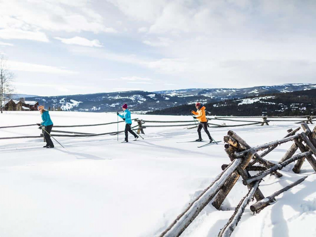 Cross Country skiers enjoy the groomed trails around Big Sky