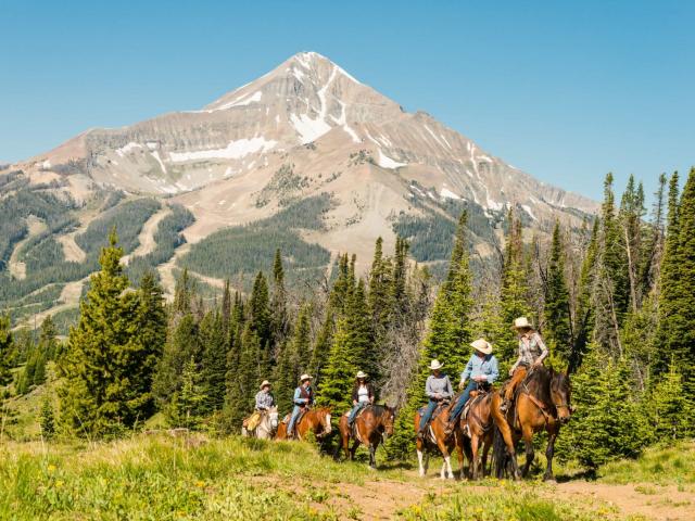 Horseback ride in Big Sky - with Lone Peak in the background.
